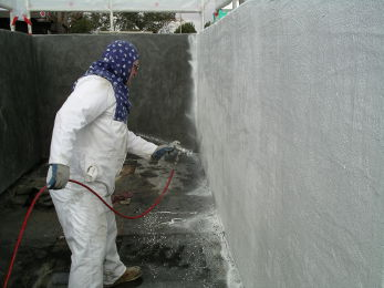 Spraying DS-5 100% Solids Epoxy Coating onto the uncured mortar